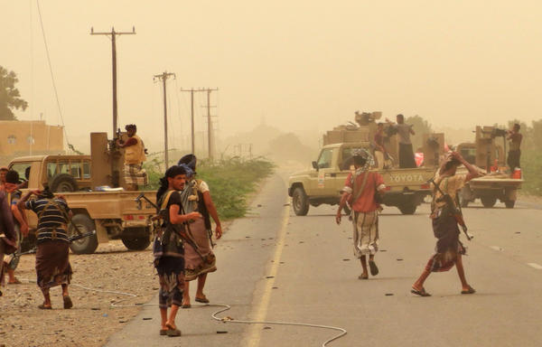 Yemeni pro-government forces gather at the south of Hodeida airport, in Yemen. Yemen's rebel chief urged his forces to fight on against pro-government troops pressing a Saudi-backed offensive to retake the key aid hub of Hodeida, as the United Nations called for the Red Sea port to be kept open.