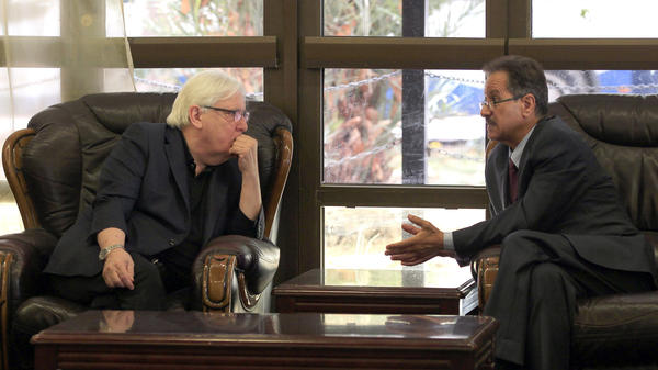 Martin Griffiths, the U.N. special envoy for Yemen, listens to Faisal Amin Abu-Rass, the undersecretary of Houthi rebel government's foreign ministry, upon his arrival at Sana'a International Airport.