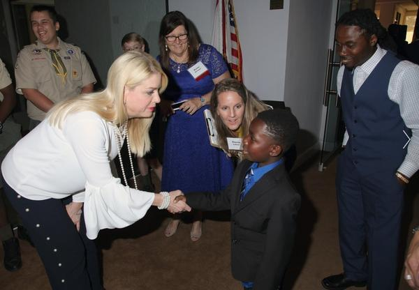 With his father looking on, Curtis Bean Jr., aka Kid Balla meets Attorney General Pam Bondi at Drug Free America Foundation.