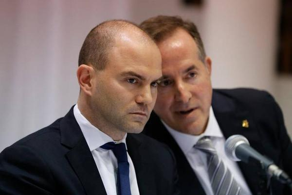Ben Rhodes, former speechwriter and a national security advisor for President Barack Obama, at left, with Jorge Mas Santos, chairman of the Cuban American National Foundation, at Miami-Dade College's Wolfson Campus on Friday, March 11, 2016.
