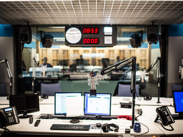 Studio 31, the home for <em>Morning Edition</em>, <em>All Things Considered </em>and <em>Weekend Edition</em>, from the view of the host and looking into the control room.