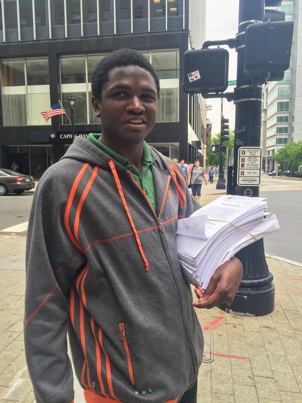 Devon Davis holding prison psychiatric records in 2016.