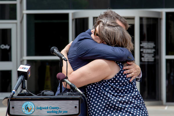 Gov. Jeff Colyer hugs Terry Brooks, the mother of Chelsea Brooks, who was murdered in 2006.