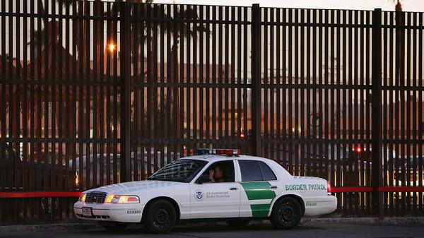 A U.S. Customs and Border Protection car parks next to the U.S.-Mexico border fence in Calexico, Calif., in 2006.