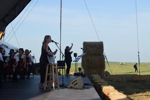 "Irish-American singer Aoife O'Donovan performs with the Kansas City Symphony during the concert. O'Donovan lead the audience in singing ""Home on the Range"" at sunset, a special tradition at the Symphony in the Flint Hills."
