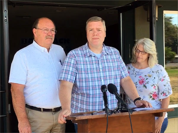Pastor David George, flanked by his wife and the Oakville, Washington, fire chief, describes pulling his pistol and fatally shooting a gunman at the Tumwater Walmart on Father's Day.