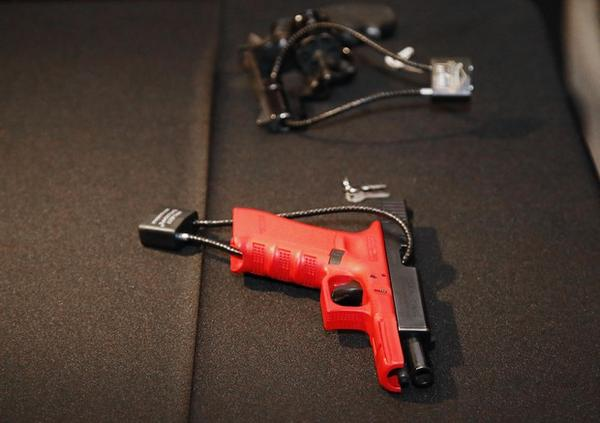 <p>Two guns secured with locks displayed in Oklahoma. A proposed ballot measure to increase gun storage requirements in Oregon has been shelved.</p>