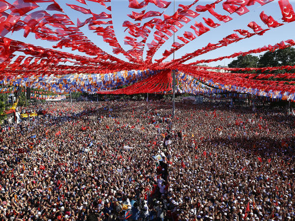 Supporters of Turkey's President Recep Tayyip Erdogan's ruling Justice and Development Party (AKP) attend an election rally in Gaziantep, eastern Turkey, on Thursday.
