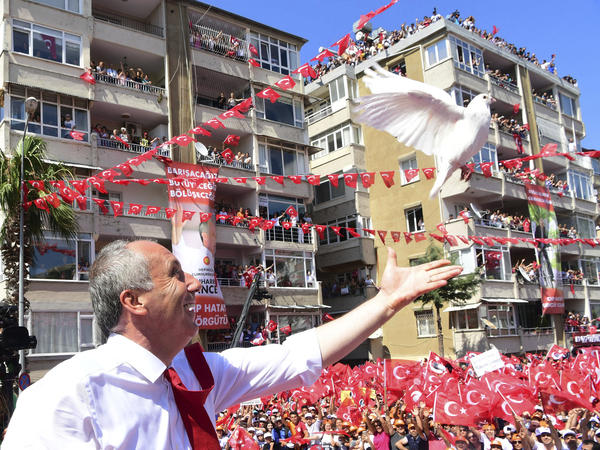 Muharrem Ince, the presidential candidate from Turkey's main opposition Republican People's Party, releases a white dove at an election rally in Hatay, Turkey, on Tuesday. The former teacher is considered Erdogan's strongest challenger.