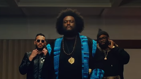 "Kamasi Washington, backed by professional gamer Gootecks, marches to challenge gamer ComboFiend in the video for ""Street Fighter Mas."""