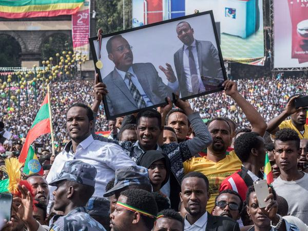 Thousands of Ethiopian Prime Minister Abiy Ahmed's supporters gathered to watch him speak at a rally Saturday in Addis Ababa. But a blast interrupted the event, leaving at least one person dead and dozens more with injuries.