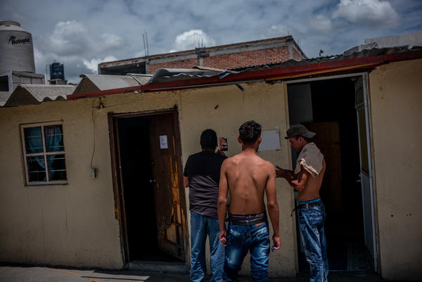 "Salvadoran migrants clean off after a week of traveling on ""The Beast."" ""A trip by train is tremendously difficult and dangerous; migrants are abused in southern Mexico primarily by criminal groups,"" a shelter director says."