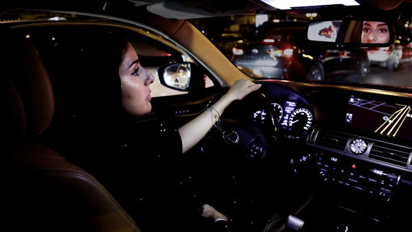 Hessah al-Ajaji drives down the busy Tahlia Street after midnight for the first time in Riyadh, Saudi Arabia, on Sunday.