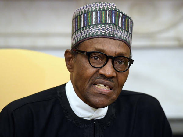 Nigeria President Muhammadu Buhari, pictured at the White House in April 2018, called for calm and vowed to bring the perpetrators of Sunday's attack to justice.