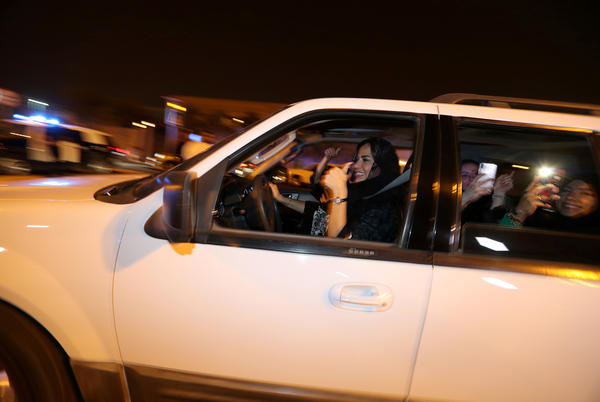 A Saudi woman celebrates with her friends as she drives her car in al-Khobar, Saudi Arabia, on Sunday. The lifting of the ban on women driving marks a milestone for women in the kingdom who have had to rely on drivers, male relatives, taxis and ride-hailing services to get to work, go shopping and simply move around.