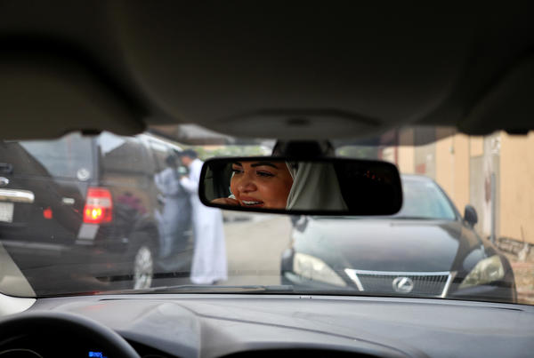 Samira al-Ghamdi, 47, a psychologist, practices driving around the side streets of a Jedddah neighborhood on June 21, in preparation to hit the road on Sunday as a licensed driver.