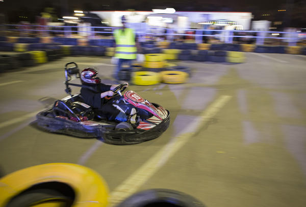 A day before the ban was lifted, a Saudi woman drives a go-kart at Riyadh Park Mall at an educational event to prepare Saudi women to take the wheel.
