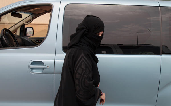 Activist Aziza Yousef, shown here stepping out of her car after driving on a Riyadh highway on March 29, 2014, as part of a campaign to defy Saudi Arabia's ban on women driving, is among several high-profile activists who were detained last month.
