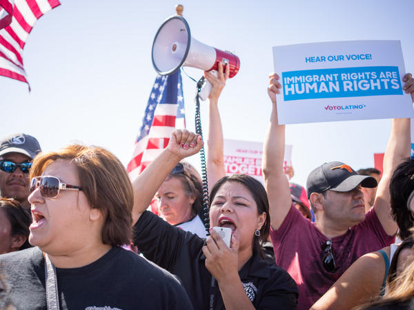 """Activists chant at an """"End Family Detention,"""" event at the Tornillo Port of Entry on Sunday."""