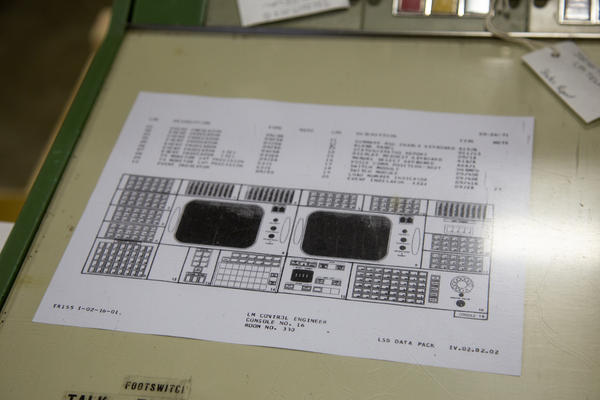 The SpaceWorks team uses a layout and original manuals to configure the console back to the Apollo-era missions.