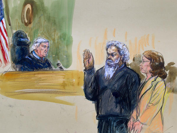 Ahmed Abu Khatallah, seen here in a 2014 artist's rendering, faces his judge during a hearing at the federal District Court in Washington, D.C.