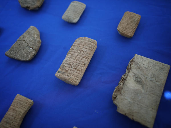Ancient artifacts seized from Hobby Lobby are shown at a May 2 event returning the artifacts to Iraq in Washington, D.C. The seized artifacts include cuneiform tablets from the little-known ancient city of Irisagrig.