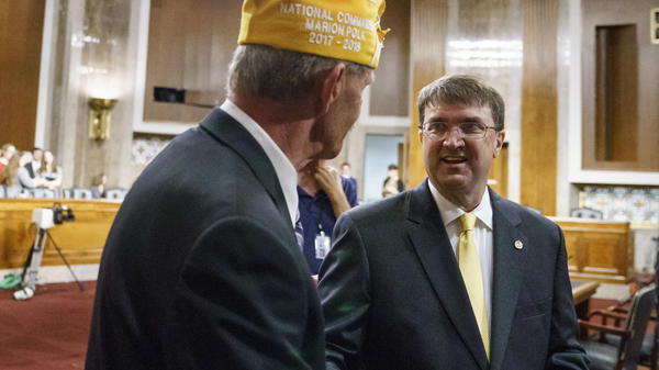 Veterans Affairs secretary nominee Robert Wilkie (right) speaks with Marion Polk, national commander of AMVETS, before testifying at a Senate Veterans Affairs Committee nominations hearing Wednesday.