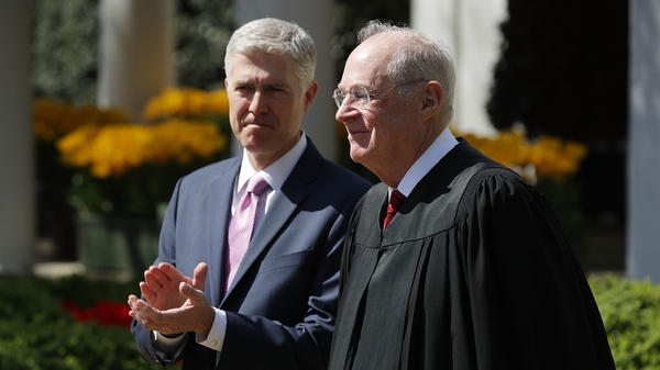 Justice Anthony Kennedy with Neil Gorsuch during Gorsuch's swearing-in ceremony at the White House on April 2017.