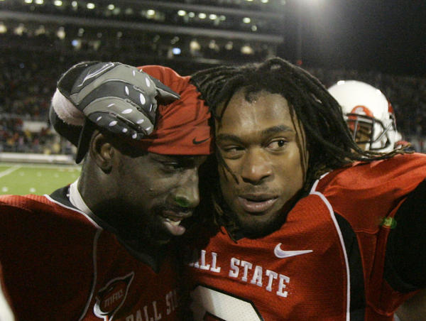Ball State linebacker Wendell Brown (left) and cornerback Trey Buice react near the end of an NCAA college football game in Muncie, Ind., in 2008. Brown, who was arrested two years ago in China, has been sentenced to 4 years in prison.