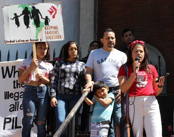 Nelson Pinos, an undocumented father of three, with his family in front of the First and Summerfield United Methodist Church