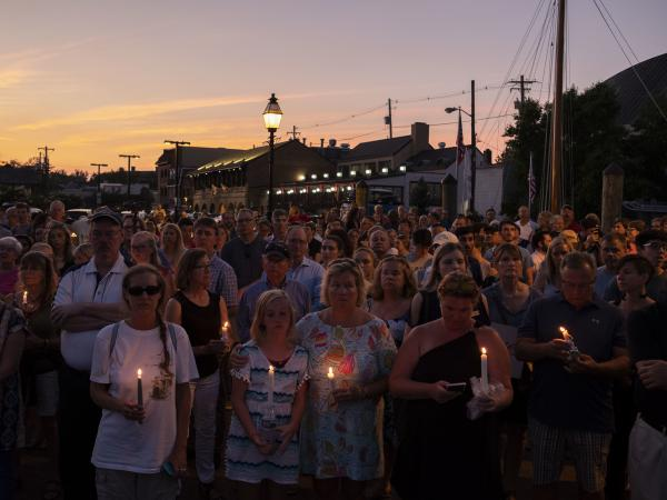 A crowd gathered in downtown Annapolis on Friday to honor five people who were killed in Thursday's attack on the Capital Gazette offices.