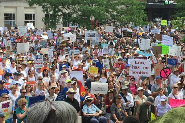 About 2,000 people protest Trump administration immigration policies outside City Hall in Portland, Maine.