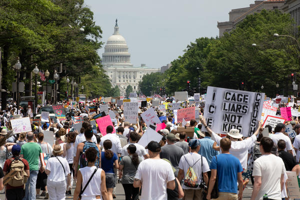 Demonstrators march to protest the immigration policy in Washington, D.C.