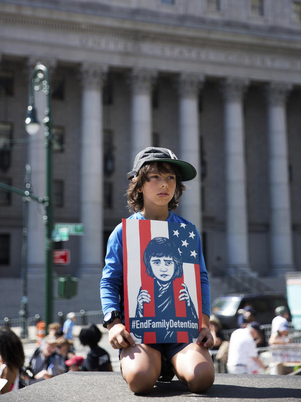 A young child holds a sign during the rally to protest the Trump administration's immigration policies in New York City.