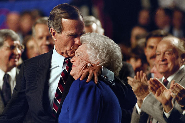 President Bush kisses Barbara during a pre-election rally at the Astro Arena in Houston on Nov. 2, 1992.
