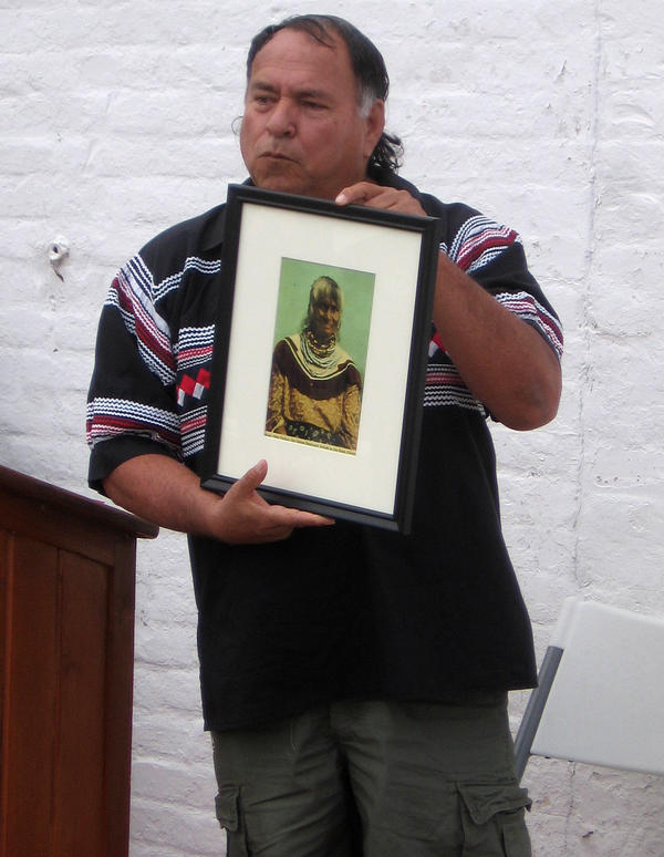 Willie Johns holds a photo of Polly Parker, his great-grandmother.