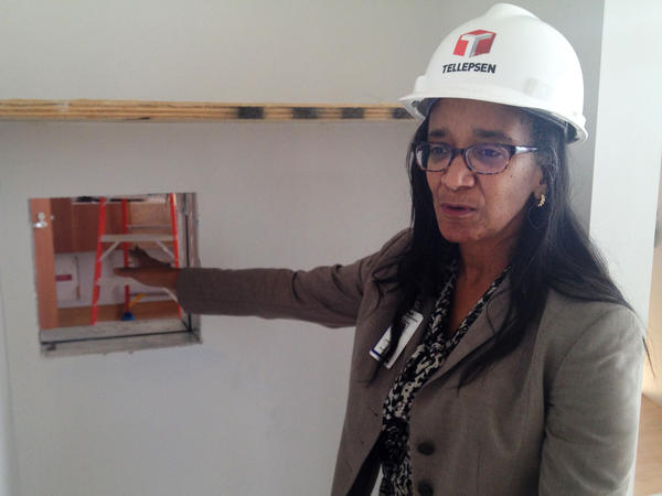 """The biocontainment unit is still under construction. Dr. Judith Campbell, a specialist in pediatric infectious disease, explains that a """"pass-through window"""" will allow health workers to make some deliveries without having to don and doff the entire protective outfit."""