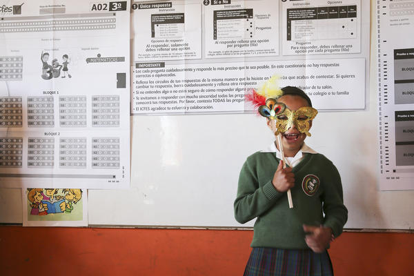 A young girl recites a local folktale as part of Escuela Nueva's Montessori-style curriculum.