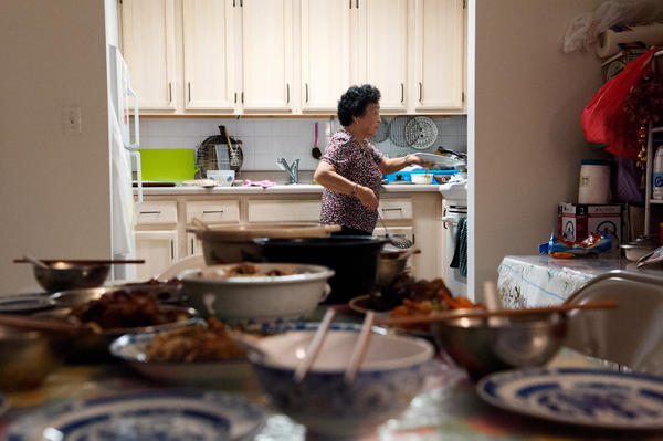 Biying Ni cooks dinner in New York City. After coming to the U.S. in 1981, Ni worked as a nanny for many years before retiring in 2000. She continues to make dishes that she grew up with in China's Fujian Province for her friends and family.