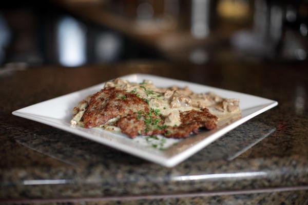 Venison is on the winter menu at Cafe Berlin, in Washington, D.C. In this dish, called Jäger Jäger, the venison schnitzel comes with hazelnut spätzle, sautéed mushrooms, and cream sauce.