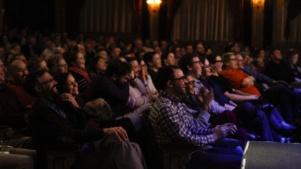 A live audience experiences NPR's Ask Me Another at The Warner Theatre in Washington, D.C.