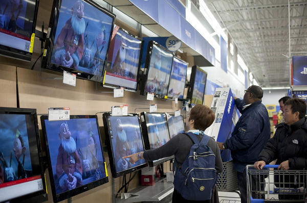 Shoppers look at televisions at a Walmart during Black Friday sales in 2012 in Quincy, Mass.