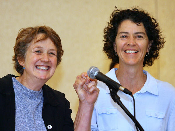 "Wendy Becker (left) and Mary Norton of Providence, R.I., raise their hands after the 2006 Massachusetts court ruling that allowed same-sex couples from Rhode Island to marry in Massachusetts. For the 2020 census, the couple can choose the new response category for ""same-sex husband/wife/spouse."""