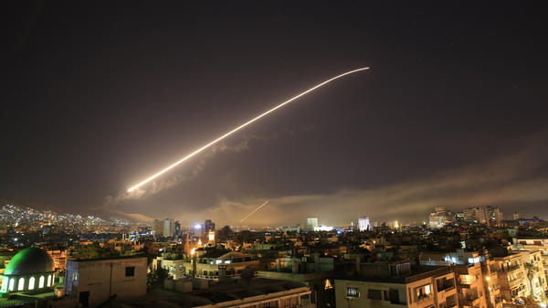 The Damascus sky lights up with missile fire as a U.S.-led coalition launches an attack early Saturday, targeting different parts of the Syrian capital.