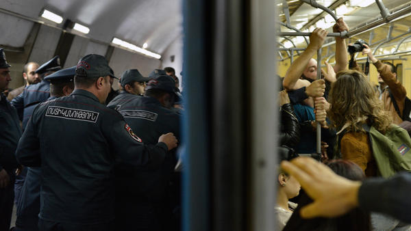 Opposition demonstrators block the entrance of an underground train during their protest Monday against former President Serzh Sargsyan's shift into the role of prime minister.