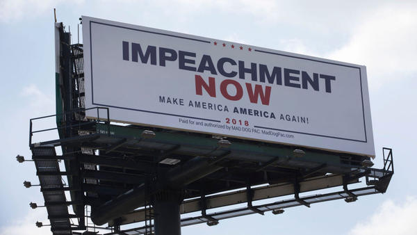 This billboard calling for President Trump's impeachment is placed along a street leading to his Mar-a-Lago resort in West Palm Beach, Fla.