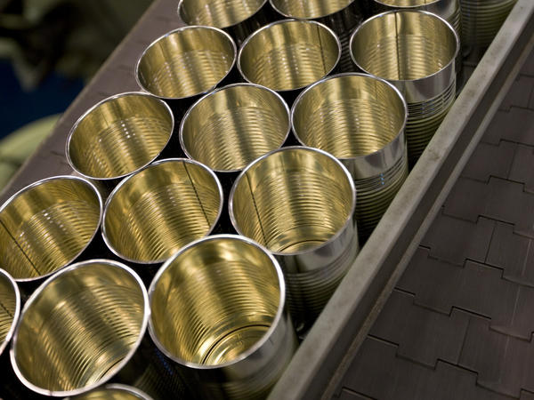 Cans are lined up at the Pacific Coast Producers plant in Oroville, Calif. The company, which cans fruits for sale in supermarkets, says new tariffs imposed by the Trump administration on steel imports will eat into its profits.