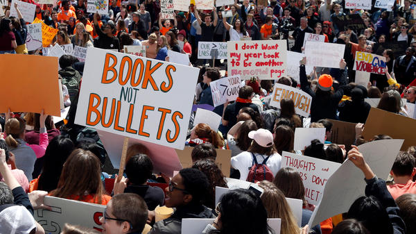 Hundreds of students gather at the State Capitol in St. Paul, Minn., on Friday to protest gun violence, part of a national high school walkout on the 19th anniversary of the Columbine High School shooting.