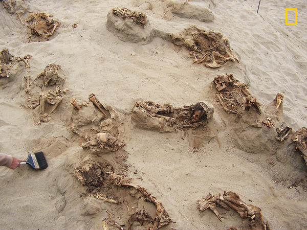 """Preserved in dry sand for more than 500 years, more than a dozen bodies were found by archaeologists. The researchers reported the """"remains were of children, ranging in age from approximately five to fourteen years."""""""