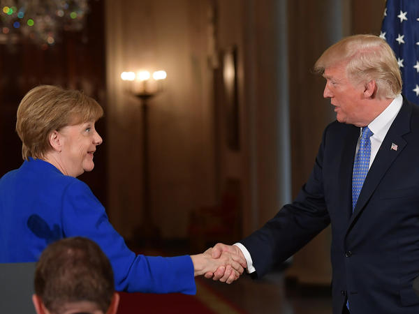 President Trump and German Chancellor Angela Merkel shake hands after a joint press conference at the White House on Friday.
